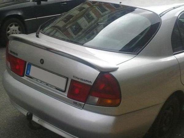 Спойлер багажника на трёх ножках MITSUBISHI Carisma (95-99) Hatchback